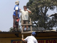 Energy Assistance Volunteers install solar panels on school roof